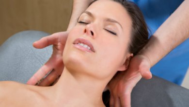 A female patient receives craniosacral fascial therapy