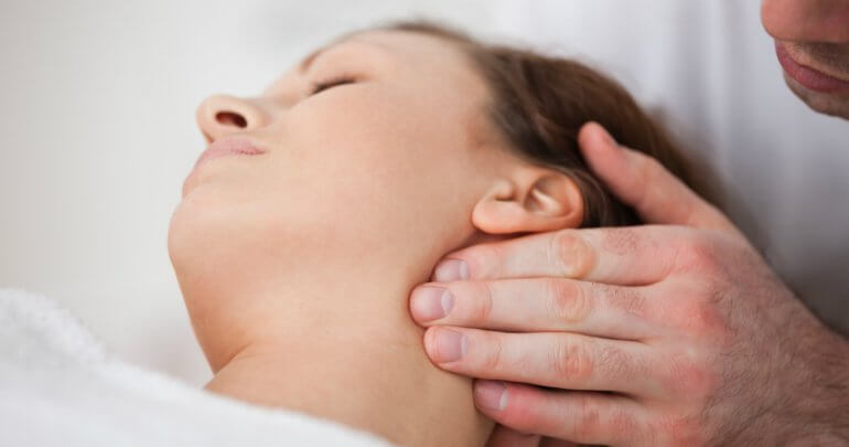 Woman receives Gillespie Approach–craniosacral fascial therapy