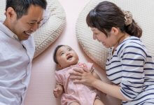 Gillespie Approach–Craniosacral Fascial Therapy transformations - Asian mother and father with baby