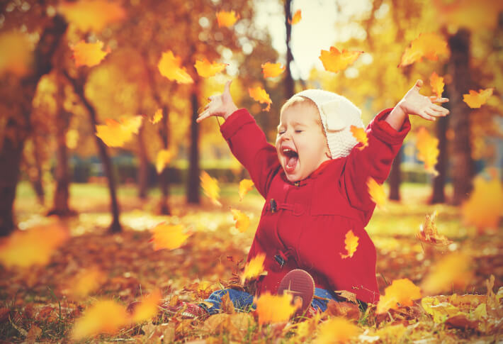 Gillespie Approach–Craniosacral Fascial Therapy - health conditions - happy child playing with leaves