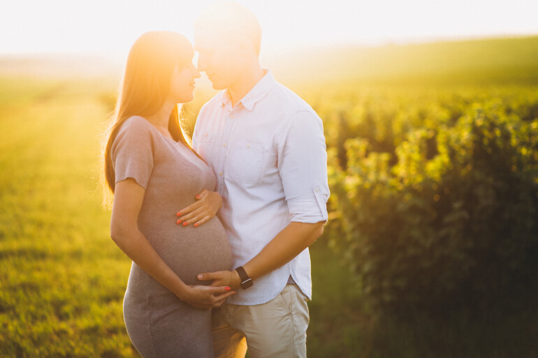 Pregnant woman with husband outside - Gillespie Approach–Craniosacral Fascial Therapy