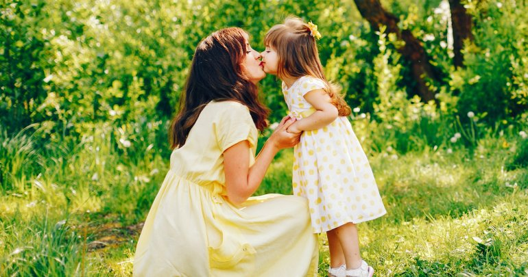 Headache - mom kissing daughter - Gillespie Approach–Craniosacral Fascial Therapy