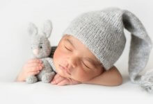 Four stages of life - baby wearing hat and sleeping - Gillespie Approach–Craniosacral Fascial Therapy