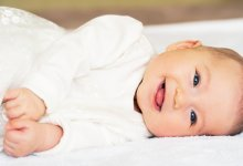 Smiling baby on side - Gillespie Approach–Craniosacral Fascial Therapy