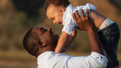 Parental patience - father lifts boy - Gillespie Approach–Craniosacral Fascial Therapy