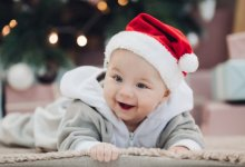 Happy baby, happy child - baby wearing Santa hat - Gillespie Approach–Craniosacral Fascial Therapy