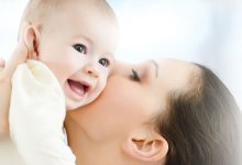 Many diverse infant conditions - mother kissing and holding baby - Gillespie Approach–Craniosacral Fascial Therapy