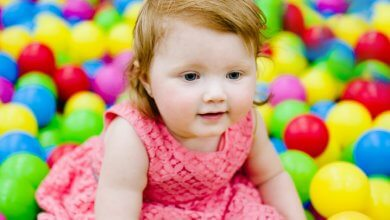 Toddler traumas - girl playing with toy balls - Gillespie Approach–Craniosacral Fascial Therapy