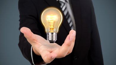 Businessman light bulb in hand - Gillespie Approach–Craniosacral Fascial Therapy
